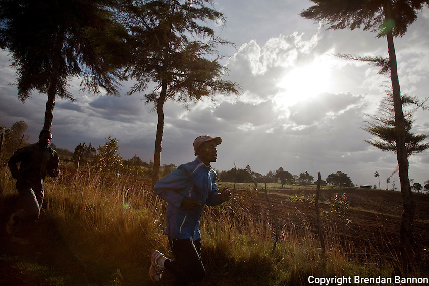 Kenyan athletes (L-R)  Joseph Langat and Elias Maindi, train in the hills close to Iten town, the country's running capital. The global recession has robbed races and runners of sponsorship, cutting their chances of earning a living from runnin