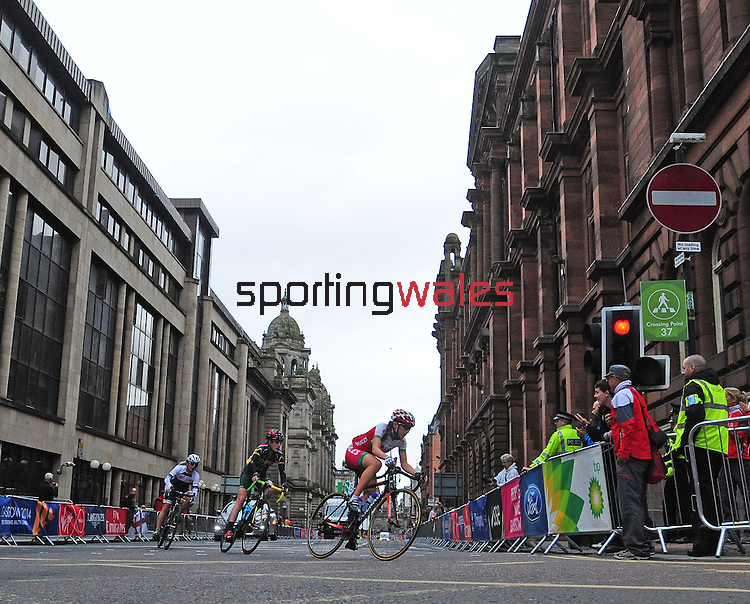Wales' Elinor Barner prepares to take the corner from George Street into Montrose Street, Glasgow<br /> <br /> Photographer Chris Vaughan/Sportingwales<br /> <br /> 20th Commonwealth Games - Day 11 - Sunday 3rd August 2014 - Cycling - Road Race - Glasgow - UK