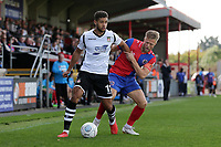 Rekeil Pyke of Wrexham and Ben Nunn of Dagenham and Redbridge during Dagenham & Redbridge vs Wrexham, Vanarama National League Football at the Chigwell Construction Stadium on 13th October 2018