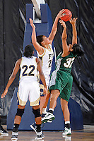 11 November 2011:  FIU's Finda Mansare (23) blocks a shot by Jacksonville's Madison Scott (32) in the second half as the FIU Golden Panthers defeated the Jacksonville University Dolphins, 63-37, at the U.S. Century Bank Arena in Miami, Florida.