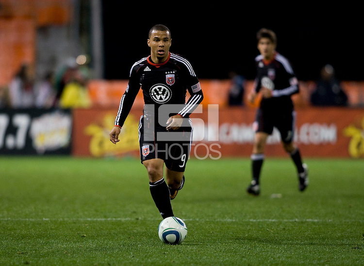 Charlie Davies (9) of D.C. United brings the ball upfield during the home opener at RFK Stadium in Washington D.C.  D.C. United defeated the Columbus Crew, 3-1.