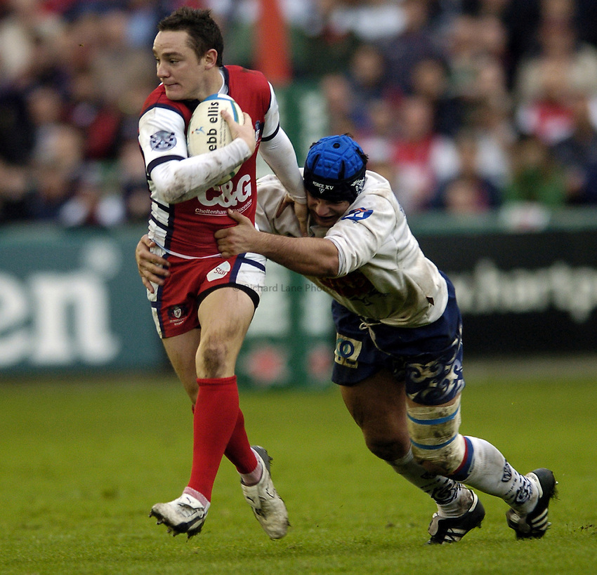 Photo: Jonathan Butler..Gloucester Rugby v Agen. Heineken Cup. 28/10/2006..Ryan Lamb of Gloucester is tackled by Peio Som of Agen.