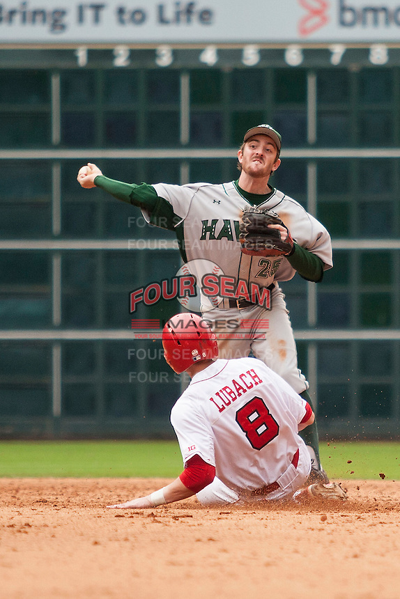 Hawaii Rainbow Warriors shortstop Jacob Sheldon-Collins (25) turns a double play during the NCAA baseball game against the Nebraska Cornhuskers on March 7, 2015 at the Houston College Classic held at Minute Maid Park in Houston, Texas. Nebraska defeated Hawaii 4-3. (Andrew Woolley/Four Seam Images)