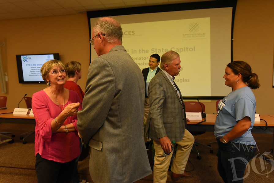 NWA Democrat-Gazette/FLIP PUTTHOFF <br /> Debbie Lamb (left) a teacher at Don Tyson School of Innovation chats with State Sen. Jim Hendren while Karla Sprague (right), a teacher at Har-Ber High School, visits with State Rep. Dan Douglas after the panel discussion.