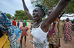 Residents of Maker Kuei, a small village outside Rumbek, South Sudan, dance as they celebrate the 10th anniversary of the establishment of the Loreto School in their community. The school is run by the Institute for the Blessed Virgin Mary--the Loreto Sisters--of Ireland.