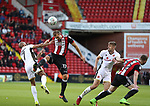 James Hanson of Sheffield Utd in action with Adam Chambers of Walsall during the Carabao Cup round One match at Bramall Lane Stadium, Sheffield. Picture date 9th August 2017. Picture credit should read: Jamie Tyerman/Sportimage