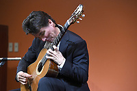 NWA Democrat-Gazette/J.T. WAMPLER Peter Fletcher performs Sunday March 18, 2018 at the Fayetteville Public Library.<br />The award-winning classical guitarist offered a program featuring a wide range of composers: Bach, Satie and Paganini among others. Fletcher began guitar study at the age of seven under John Sutherland.  Fletcher furthered his studies in master classes with David Leisner, David Russell, Oscar Ghiglia and Pepe Romero. As a performer in the Christopher Parkening Master Class in 1988, he was broadcast on National Public Radio. In 1990, the Music Teacher&acirc;&euro;&trade;s National Association (MTNA) awarded Fletcher a prize at its National Level Competition, and in 1995 he received the Master of Music degree from the Eastman School of Music under Nicholas Goluses, and was twice the recipient of an Eastman Graduate Award. Current recordings involve an all-Grieg album, for which he himself wrote the guitar transcriptions, released in 2014, and a Christmas Album in 2015. His current CD features live performances of Bach&acirc;&euro;&trade;s First Lute Suite, Ravel&acirc;&euro;&trade;s Empress of the Pagodas, Leyenda and Sevilla by Albeniz, and music by Tansman, Reusner, Couperin, de Visee, Satie and Carlo Domeniconi. Peter divides his time between Detroit and New York City.