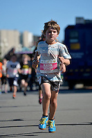 Cigna Kids Waterfront Fun Run at Frank Kitts Park, Wellington, New Zealand on Tuesday 16  December 2014. <br /> Photo by Jo Hawes. <br /> www.photowellington.photoshelter.com.