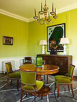 In this bright morning room Wilson Kerr has designed the rug and the curtain pelmet and has furnished it with a sideboard from France and a large painting by Anita Klein