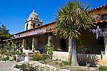 Monterey County, CA<br /> Tower of the Carmel Mission Basilica (1797) above the cloister walk and courtyard gardens - Mission San Carlos Borromeo del Rio Carmelo