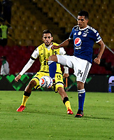 BOGOTA - COLOMBIA - 22 – 03 - 2018: David Mackalister Silva (Der.) jugador de Millonarios disputa el balón con Freddy Florez (Izq.) jugador de Alianza Petrolera, durante partido aplazado de la fecha 8 entre Millonarios y por la Liga Aguila I 2018, jugado en el estadio Nemesio Camacho El Campin de la ciudad de Bogota. / David Mackalister Silva (R) player of Millonarios vies for the ball with Freddy Florez (L) player of Alianza Petrolera, during a posponed match of the 8th date between Millonarios and Alianza Petrolera, for the Liga Aguila I 2018 played at the Nemesio Camacho El Campin Stadium in Bogota city, Photo: VizzorImage / Luis Ramirez / Staff.