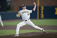 Michigan Wolverines pitcher Tommy Henry (47) delivers a pitch to the plate against the Michigan State Spartans during the NCAA baseball game on April 18, 2017 at Ray Fisher Stadium in Ann Arbor, Michigan. Michigan defeated Michigan State 12-4. (Andrew Woolley/Four Seam Images)