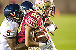 Virginia cornerback Tim Harris, left, wraps up Florida State wide receiver Rashad Greene when Florida State defeated Virginia 34-20 in an NCAA football game in Tallahassee, FL November 8, 2014