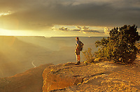 Hiker Stands on Grand Canyon Rim near Hopi Point at summer sunset, Grand Canyon National Park, Arizona, AGPix_0355..
