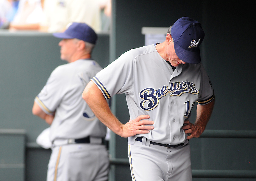 17 JULY 2011:  Milwaukee Brewers manager Ron Roenicke (10) hangs his head in the dugout    during a regular season game between the Milwaukee Brewers and the Colorado Rockies at Coors Field in Denver, Colorado. The Brewers beat the Rockies 4-3 to split the four game series. *****For Editorial Use Only*****