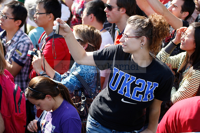 An onlooker leans to take a photo during President Bill Clinton's speech at the University of Kentucky on Monday, October 11, 2010.  Photo by Latara Appleby | Staff