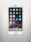 Gold white Apple iPhone 6 6s with desktop icons on its display isolated on light gray background with clipping path