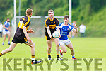 Shane Doolan Dr Crokes lays off to Gavin O'Shea being tracked by Gearoid Savage Kerins O'Rahillys  during the County league clash in Killarney on Saturday