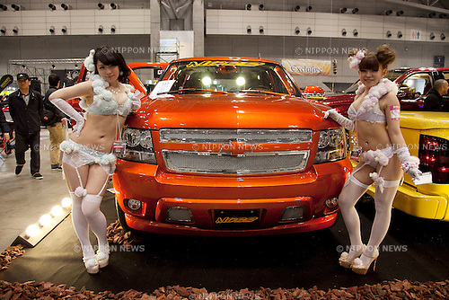 "April 21, 2013, Chiba, Japan - Go-Go dancers pose for the camera next to a customer car. The ""New Style Custom Autoshow NEXT 2013"" for 5th time comes to Makuhari Messe to show luxury custom cars (Lamborghini, Maserati, Cadillac, Honda, Chevrolet, etc) which compete in 16 different ""New Style"" categories. The exhibition brings beautiful Go-Go dancers who perform on the stage and pose for the cameras of visitors. The car show brings the ultimate of technology in illumination, audio and video system; car accessories, rims and new designs on chassis, everything to custom luxury cars. (Photo by Rodrigo Reyes Marin/AFLO).."