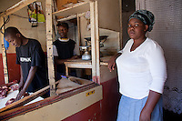 """Elizabeth Okumu, 34, has plans to grow her butcher's shop serving the residents of Nairobi's Kibera slum, to 'refine' its appeal to its customers. """"Maybe I will add some extra seating's, maybe even open another outlet in another slum. Why not?"""""""