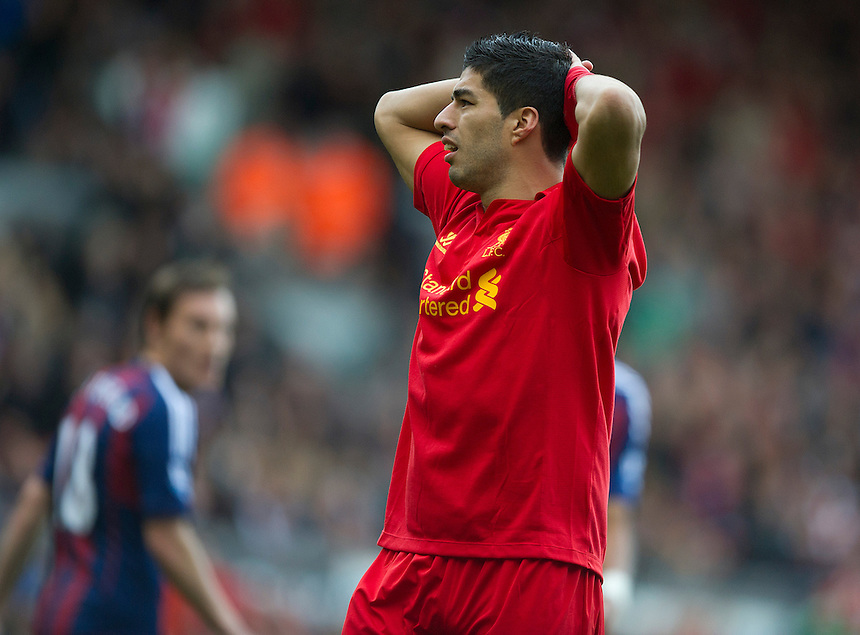 Liverpool's Luis Suarez shows his frustration at missing a chance of scoring..Football - Barclays Premiership - Liverpool v Stoke City - Sunday 7th October 2012 - Anfield - Liverpool..
