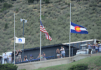 Jul, 20, 2012; Morrison, CO, USA: Flags fly at half mast in remembrance of those killed and injured in the Aurora, CO movie theater shooting the previous night, during NHRA qualifying for the Mile High Nationals at Bandimere Speedway. Mandatory Credit: Mark J. Rebilas-US PRESSWIRE
