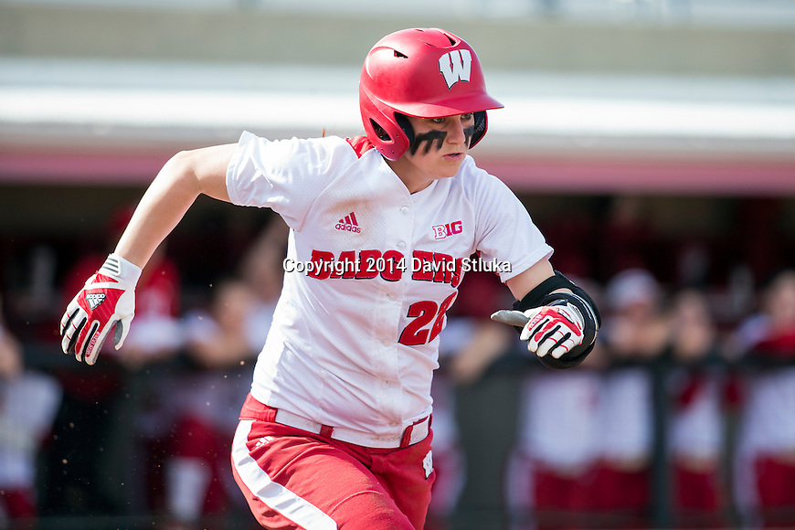 Wisconsin Badgers short stop Stephanie Peace (22) runs to first base during the first game of a double header during an NCAA softball game against North Dakota Wednesday, April 9, 2014, in Madison, Wis. (Photo by David Stluka)
