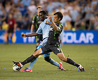 C.J. Sapong (17) of Sporting Kansas City fights for the ball with Patrick Ianni (4) of the Seattle Sounders during the game at Livestrong Sporting Park in Kansas City, Kansas.   Sporting Kansas City won the Lamar Hunt U.S. Open Cup on penalty kicks after tying the Seattle Sounders in overtime.