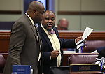 Nevada Assembly Democrats William Horne, left, and Jason Frierson work on the Assembly floor at the Legislative Building in Carson City, Nev., on Friday, May 24, 2013. <br /> Photo by Cathleen Allison