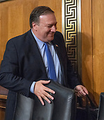 """United States Secretary of State Mike Pompeo departs after over three hours of testimony before the US Senate Committee on Foreign Relations on """"An update on American Diplomacy to Advance our National Security Strategy"""" on Capitol Hill in Washington, DC on Wednesday, July 25, 2018.  Pompeo took questions on the Helsinki Summit with President Putin of Russia and progress on the denuclearization of North Korea.<br /> Credit: Ron Sachs / CNP"""