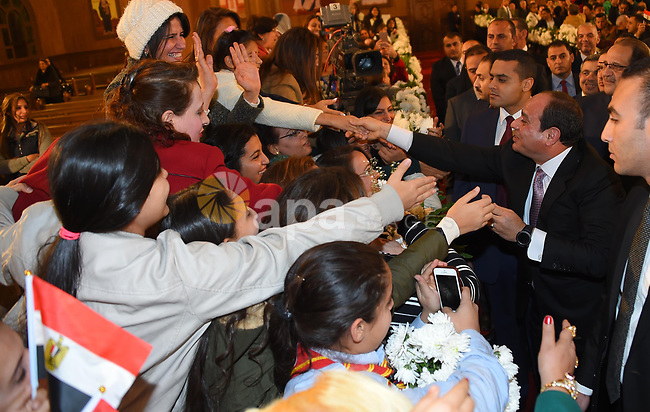 """Egyptian President Abdel Fattah al-Sisi greets faithful at the new Coptic Cathedral """"The Nativity of Christ"""", in Cairo, Egypt, January 6, 2018. Photo by Egyptian President Office"""