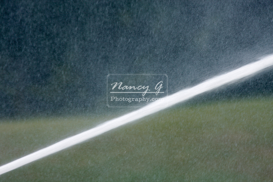 A water line spray from a fire department hoseline