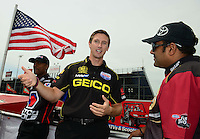 Jun. 29, 2012; Joliet, IL, USA: NHRA top fuel dragster driver Morgan Lucas (center) talks with Khalid Albalooshi during qualifying for the Route 66 Nationals at Route 66 Raceway. Mandatory Credit: Mark J. Rebilas-