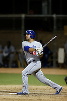 Julian Leon #44 of the AZL Dodgers bats against the AZL Athletics at Phoenix Municipal Stadium on July 10, 2013 in Phoenix, Arizona. AZL Athletics defeated the AZL Dodgers, 7-1. (Larry Goren/Four Seam Images)
