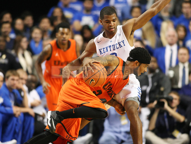 University of Kentucky sophomore guard Aaron Harrison (2) guards University of Pikeville junior guard KK Simmons (24) during the first half of the UK men's exhibition basketball game vs. the University of Pikeville at Rupp Arena in Lexington, Ky., on Sunday, November 2, 2014. UK won 116-68. Photo by Tessa Lighty | Staff