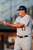 Greeneville Astros manager Omar Lopez #22 argues a call during a game against the Johnson City Cardinals at Howard Johnson Field on July 13, 2011 in Johnson City, Tennessee.  Greeneville won the game 7-4.   (Tony Farlow/Four Seam Images)