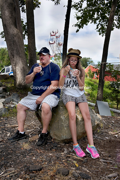Wolcott, CT- 22 August 2015-082215CM01-   Joe Rosselot Wolcott, left, of Wolcott and his daughter Jillian Rosselot, 13 have an ice cream cone during the Wolcott Fair on Saturday.  The fair will continue on Sunday from 10a.m until 10 p.m.   Christopher Massa Republican-American
