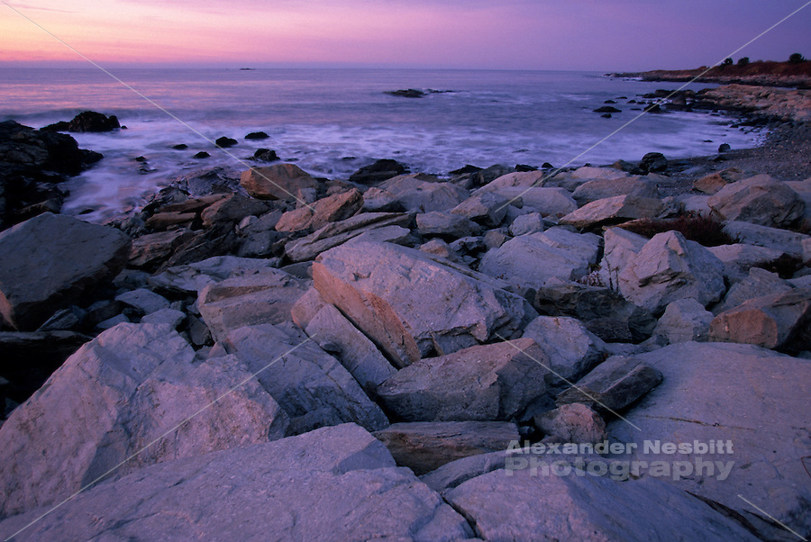 USA, Newport, RI - Sunrise reflects on the rocky shore of Sachuest point.
