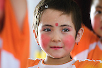 A beautiful young girl performs at a elementary school that is a mix of Chinese and Uyghur students in the remote Xinjiang Uyghur Autonomous Region of northwest China.