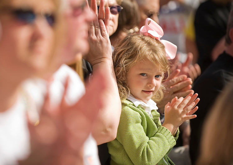 A child applauds during Senate candidate Jack Conway's (D) stump speech at the Hillbilly Days festival in Pikeville, Ky., April 17, 2010.