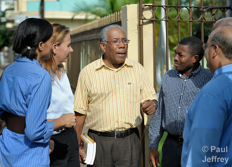 Samuel Grano de Oro is a United Methodist missionary in the Dominican Republic, where he serves as dean of the Evangelical Theological Seminary of the Dominican Evangelical Church. Here he talks after a class at the seminary, located in Santo Domingo, with Elsa Thomas (left), Marisol Landay, Erasme Figaro, and Ramon de Moya.