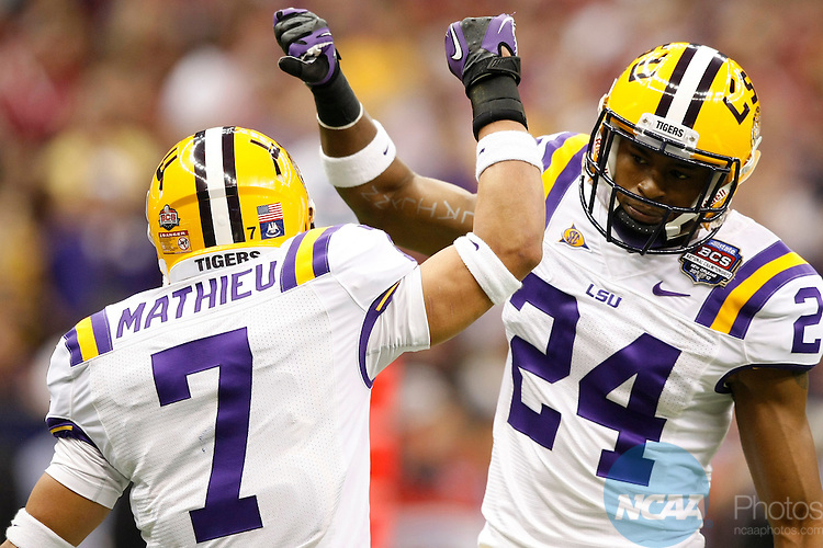 09 JAN 2012:  Tharold Simon (1) of Louisiana State University congratulates Tyrann Mathieu (7) on a defensive stop against the University of Alabama during the 2012 Allstate BCS Championship held at the Mercedes-Benz Superdome in New Orleans, Louisiana.  Alabama defeated LSU 21-0 to win the national championship game.  Jamie Schwaberow/NCAA Photos