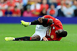 Paul Pogba of Manchester United goes down with an injury during the Premier League match at Old Trafford Stadium, Manchester. Picture date: September 24th, 2016. Pic Sportimage