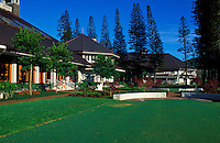 Grounds and buildings of the lodge at Koele, Lanai with a person on steps