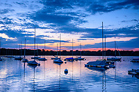 Sailboats at dawn on Lake Harriet in Minneapolis, Minnesota.