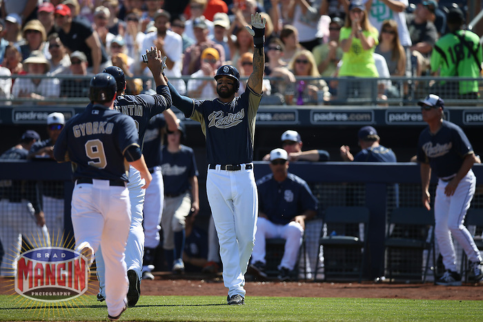 PEORIA, AZ - MARCH 8:  Matt Kemp of the San Diego Padres celebrates with his teammates after scoring a run against the Colorado Rockies during a spring training game at the Peoria Sports Complex on March 8, 2015 in Peoria, Arizona. (Photo by Brad Mangin)