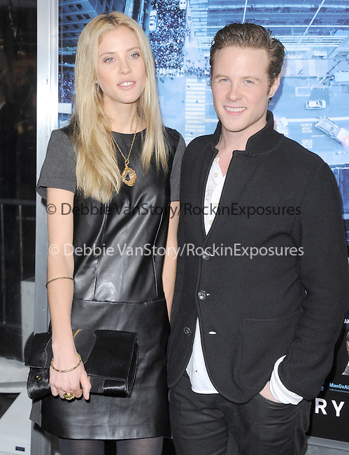 Ashton Holmes and girlfriend at Summit Entertainment's L.A. Premiere of  Man on a Ledge held at The Grauman's Chinese Theatre in Hollywood, California on January 23,2012                                                                               © 2012 Hollywood Press Agency