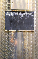 Syrah. Domaine d'Aupilhac. Montpeyroux. Languedoc. Sign on tank. Stainless steel fermentation and storage tanks. France. Europe.