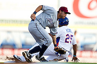 Anthony Seratelli (2) of the Northwest Arkansas Naturals attempts to tag out a baserunner during a game against the South All-Stars 2011 in the Texas League All-Star game at Nelson Wolff Stadium on June 29, 2011 in San Antonio, Texas. (David Welker / Four Seam Images).