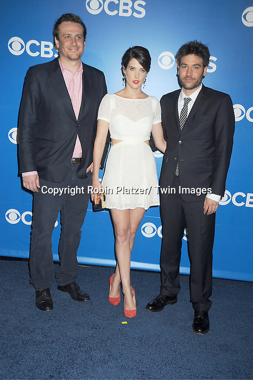 """Jason Segal, Cobie Smulders and Josh Radnor of """" How I Met Your Mother"""" attends the CBS Upfront 2012 at The Tent at Lincoln Center in New York City on May 16, 2012."""